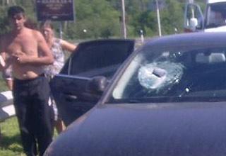Brick from truck killes woman in passing car