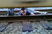 Idiot under a speeding train