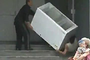 Drunk carrying a freezer