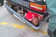 immigrant smuggled in car bumper