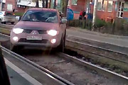 Car stuck on tram tracks