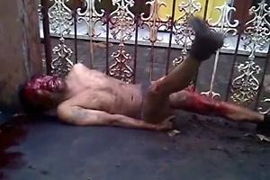Dying Man handcuffed to the Gate