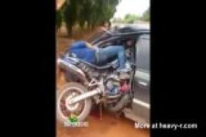 Motorcycle Parked Inside Car