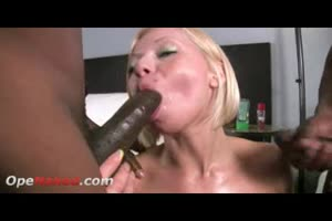 Nympho blond Milf throating and sucking 2 BBCs