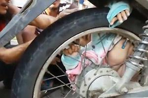 Baby Stuck In Wheel after Traffic Accident
