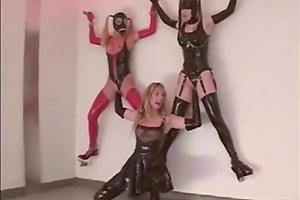 Latex Slaves Fisted On A Wall