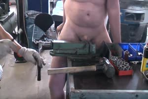 She has his cock & balls in a vice