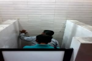 A peeping Tom views two guys fucking in a toilet stall