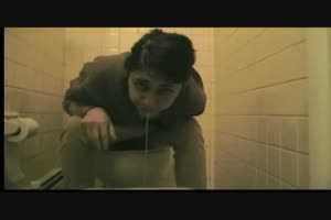 Brunette Girl Puking In a Toilet