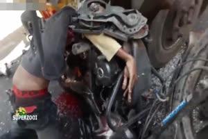 Dead Biker Stuck In Truck